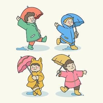 Bambini che giocano quando piove