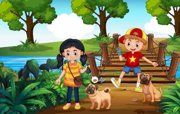 Bambini che camminano cani e prendete la cacca