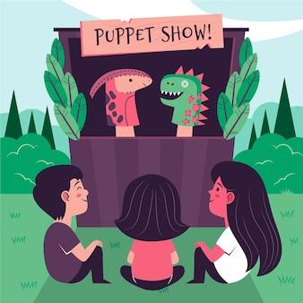 Bambini che guardano uno spettacolo di marionette illustrato