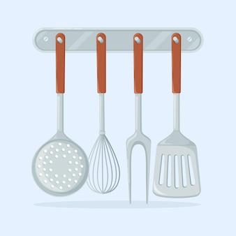 Accessori per la cucina. pinna, colino, spatola, mestolo.