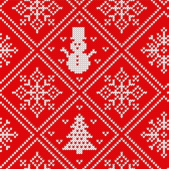 Motivo natalizio a maglia. fondo senza cuciture lavorato a maglia. . trama maglione di natale. stampa rossa festosa