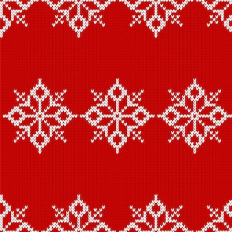 Modello natalizio lavorato a maglia. fondo senza cuciture rosso. illustrazione vettoriale.