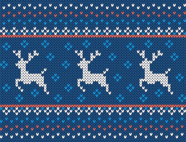 Trama di natale a maglia. modello senza soluzione di continuità con i cervi. stampa maglione lavorato a maglia blu. ornamento di lana di natale.