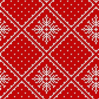 Maglia senza cuciture. sfondo di natale. . trama di maglione lavorato a maglia. stampa rossa di inverno festivo di natale con i fiocchi di neve. ornamento tradizionale di festa fiera. pullover in lana. Vettore Premium