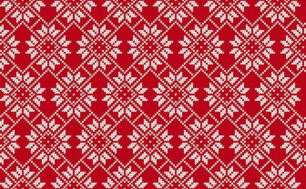 Modello senza cuciture a maglia. trama a maglia rossa. sfondo di natale. stampa tradizionale dell'isola di fair. ornamento di festa
