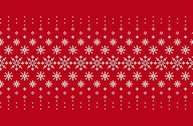 Modello senza cuciture a maglia. trama a maglia rossa con fiocchi di neve. bordo di natale. fondo tradizionale dell'isola di fair.