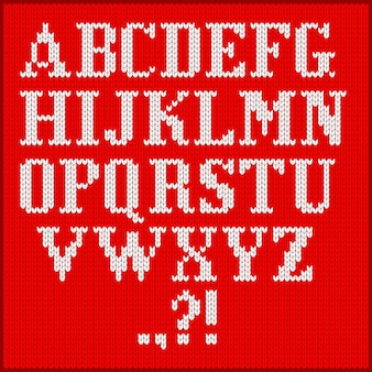 Insieme di alfabeto a maglia. illustrazione del fumetto piatto vettoriale. lettere bianche su uno sfondo di trama di panno rosso.