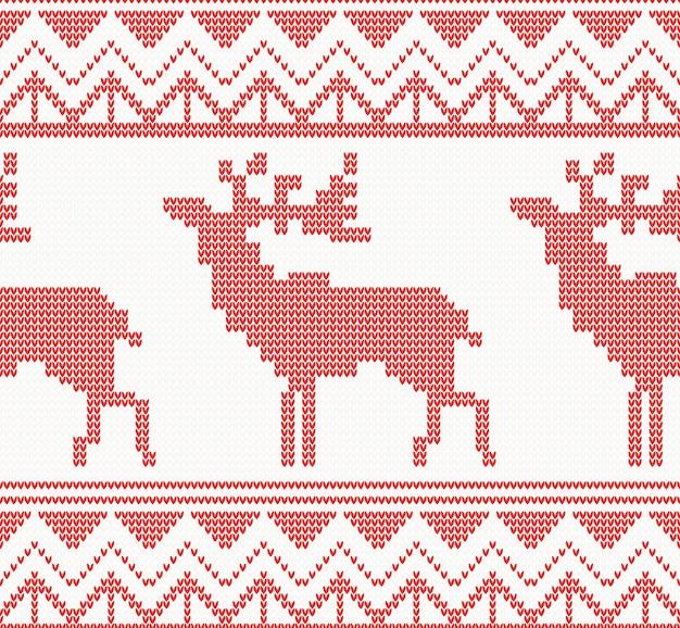 Modello senza cuciture dei cervi lavorati a maglia in colore rosso.