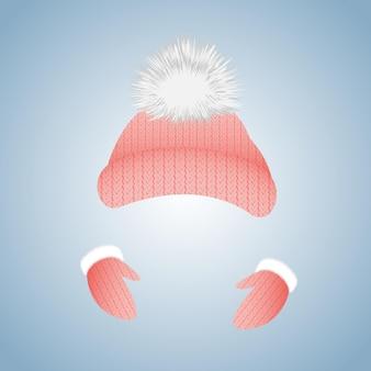 Cappello in maglia con pompon e guanti con pelliccia.