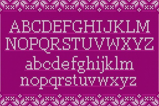 Alfabeto latino lavorato a maglia su sfondo senza soluzione di continuità