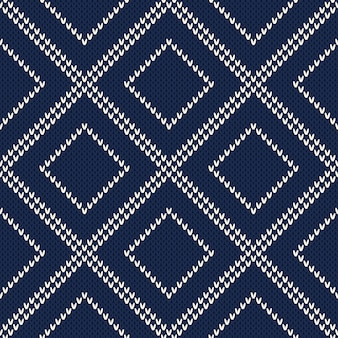 Modello maglione lavorato a maglia. sfondo senza soluzione di continuità. imitazione di texture in maglia di lana