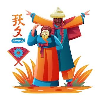 Danza in maschera di coppia coreana per il festival di chuseok