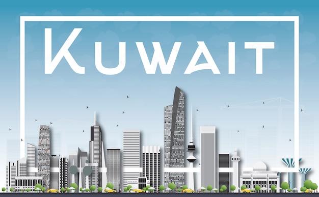 Kuwait city skyline con edifici grigio, cielo blu e cornice bianca.
