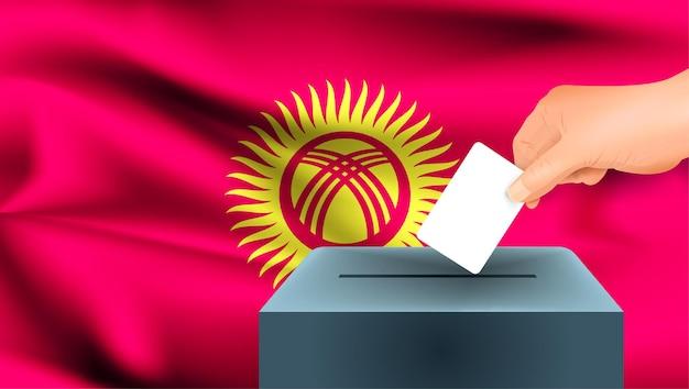 Bandiera del kirghizistan, voto maschio della mano con il fondo di idea di concetto della bandiera del kirghizistan