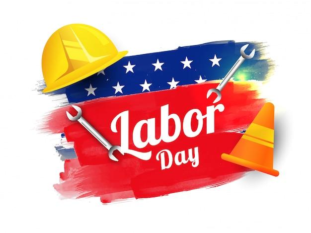 Testo di festa del lavoro con lo strumento della costruzione sul colore della bandiera americana di effetto del colpo della spazzola Vettore Premium