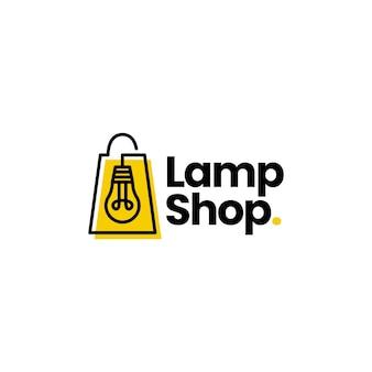 Modello di logo della borsa della spesa del negozio di luce della lampadina della lampada