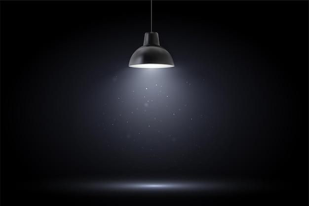 Lampada in camera oscura. riflettori puntati su sfondo nero.