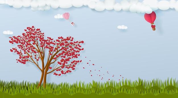 Paesaggio con due alberi a forma di cuore con palloncini per san valentino.