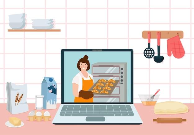 Un laptop in cucina con una lezione online sulla cottura dei croissant. video blog di cucina