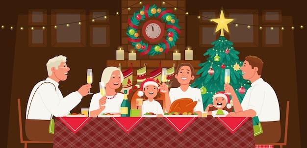 La famiglia numerosa festeggia il natale o il nuovo anno. nonna e nonno, mamma, papà e bambini sono seduti a tavola e cenano. accogliente albero di natale con caminetto.