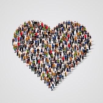 Grande gruppo di persone a forma di segno del cuore