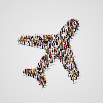 Grande gruppo di persone a forma di aeroplano