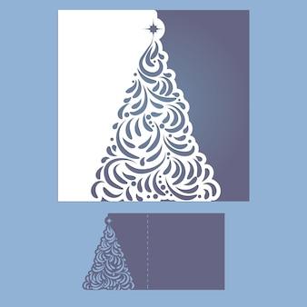 Modello di taglio della cartolina di natale tagliato al laser con l'albero di natale.