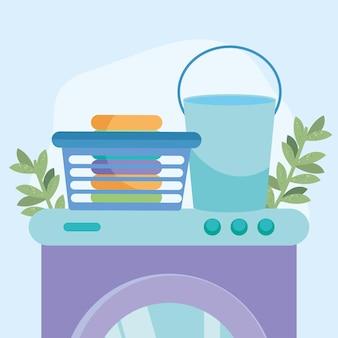 Cesto della biancheria e secchio sulla lavatrice su sfondo blu