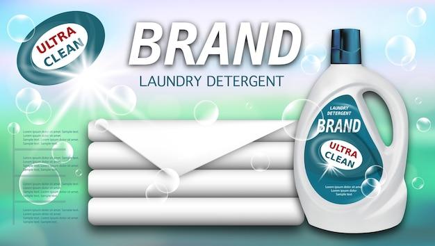 Detersivo per bucato in contenitore di plastica e asciugamani puliti, confezione per detersivi liquidi.