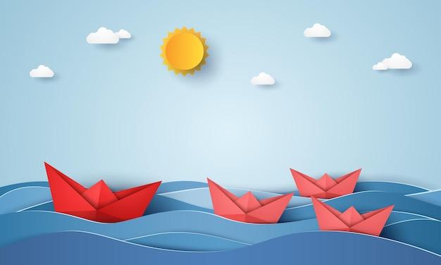 Concetto di leadership, barca origami che naviga nell'oceano blu, stile di arte della carta