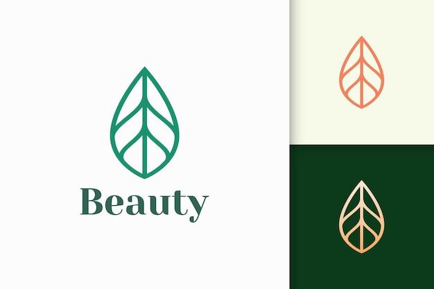 Il logo di foglie o piante a forma di linea semplice rappresenta la bellezza e la salute