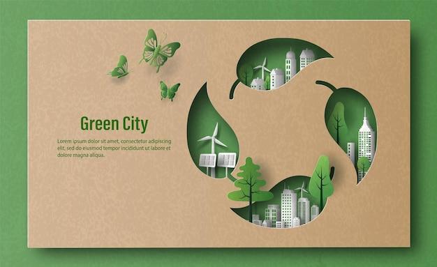 Un simbolo di riciclaggio delle foglie con la città verde in stile carta