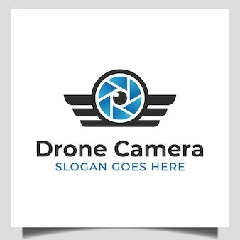 Video della fotocamera con obiettivo con simbolo delle ali per drone moderno, design del logo dello studio fotografico