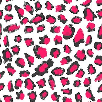 Motivo con stampa leopardata. macchie rosso-nere su fondo bianco.