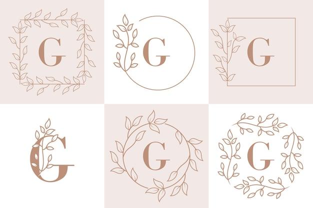 Lettera g iniziale con modello di cornice floreale