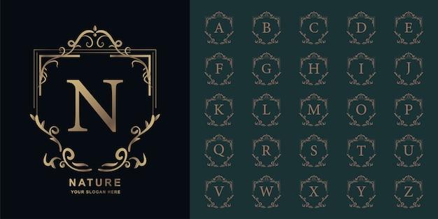 Lettera n o alfabeto iniziale di raccolta con modello di logo dorato di lusso ornamento cornice floreale.