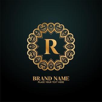 Lettera r logo del marchio di lusso dorato