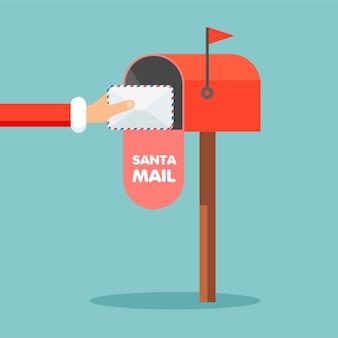 Lettera a babbo natale. cassetta postale rossa con busta all'interno in stile cartone animato.
