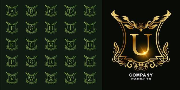 Lettera u o alfabeto iniziale di raccolta con modello di logo dorato cornice floreale ornamento di lusso.