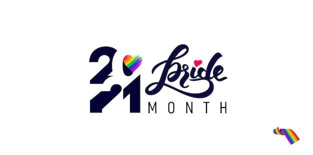 Iscrizione con i colori dell'arcobaleno del cuore con i testi 2021 pride month, concetto per la comunità lgbtq nel mese dell'orgoglio. mese dell'orgoglio della comunità arcobaleno di vettore. amore, libertà, supporto, simbolo piatto di pace.