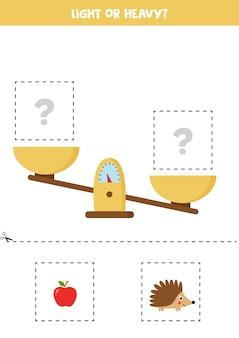 Leggero, pesante o uguale. foglio di lavoro educativo con scale. introduzione del peso per i bambini.