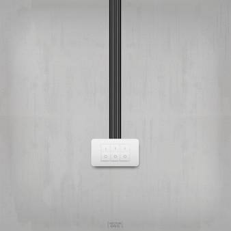 Interruttore della luce sulla priorità bassa del muro di cemento