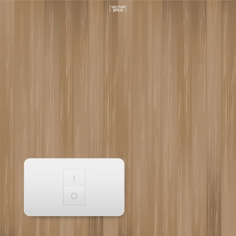 Interruttore della luce sul fondo della parete in legno