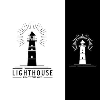 Logo del faro in sfondo bianco e nero Vettore Premium