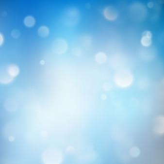 Luci su sfondo blu effetto bokeh.