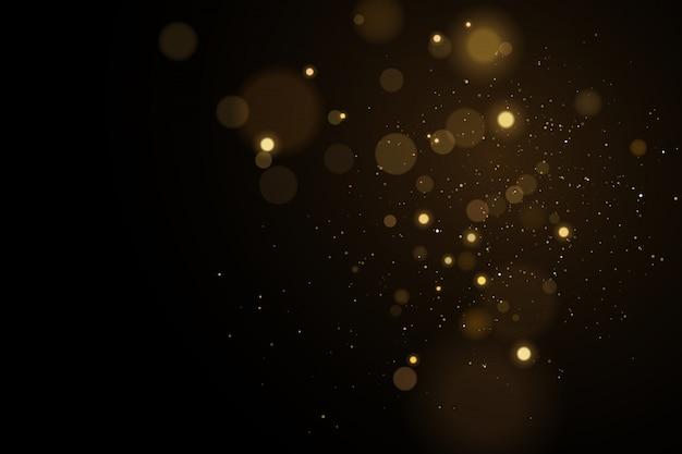 Accende il bokeh su un fondo nero. riflessi con particelle luminose volanti. effetto oro chiaro.