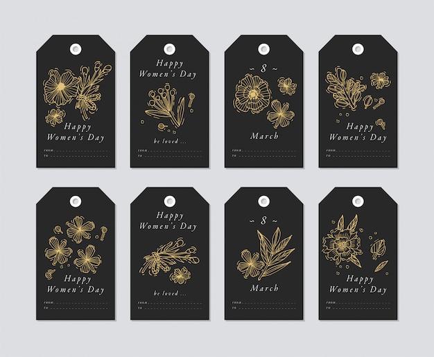 Lineare per gli elementi di saluti della giornata della donna su sfondo bianco. le etichette di vacanze di primavera hanno messo con tipografia e l'icona dorata.
