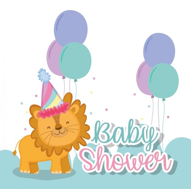Leone con cappello da festa e palloncini per festeggiare la baby shower
