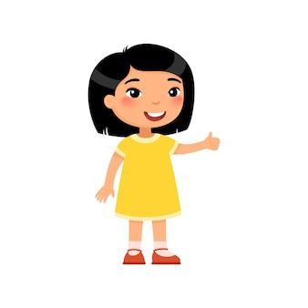 Piccola ragazza asiatica che mostra pollice in alto gesto