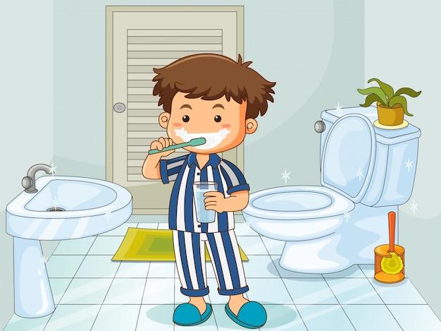 Ragazzino lavarsi i denti nella toilette